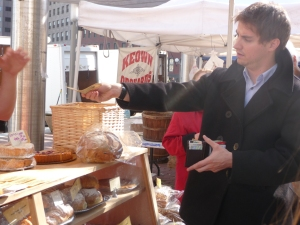 Colin exchanges his SN paycheck for some delicious cranberry walnut bread!